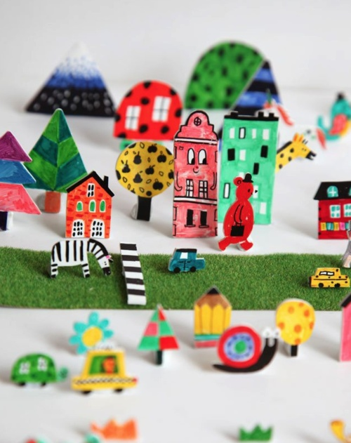 Let kids draw, color and cut 3D paper city, farm, zoo, forest or any other place to use as miniature video scenario. Puppets can be handled from above with straws.