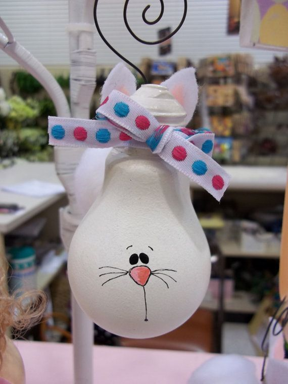 Easter Light Bulb Ornament Bunny  site shows where item is for sale, but it looks easy enough to make yourself with spray paint, cloth, ribbon and markers.