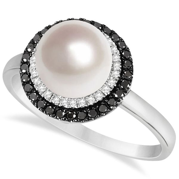 This halo fashion ring features one 8mm light cream to pinkish-white pearl surrounded by a halo of white diamonds which is encased in another halo of black diamonds.With a total of 57 diamonds of approximately one quarter carat a single cultured pearl is bathed in shimmering reflective light.Perfect as a fashion right hand or individual finger ring this 14k white gold freshwater pearl and diamond ring will add sophistication to any outfit.