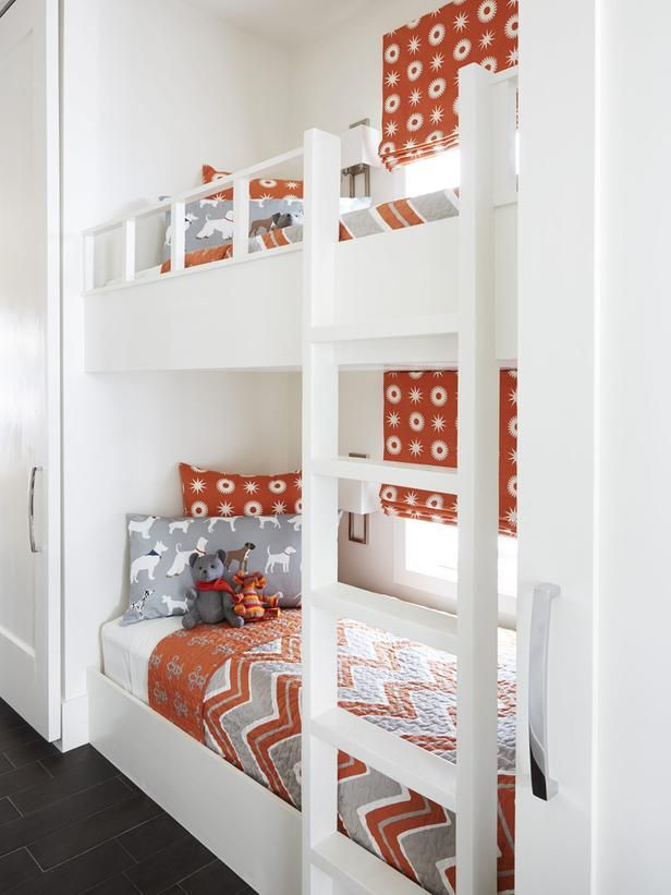 Bunk Bed Nook: Tucked into a hallway, the twin-size custom sleepers each have a reading light, little TV, and quilt from Vern Yip's HSN line. Sliding doors keep the space out of sight when it's not in use. (could use Rustica doors...nice sleeping arrangement for basement area)
