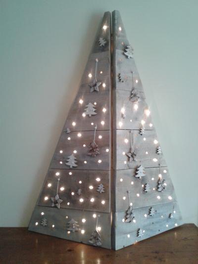 Bekijk de foto van ellenhendriks met als titel Kerstboom gemaakt van steigerhout en andere inspirerende plaatjes op Welke.nl.