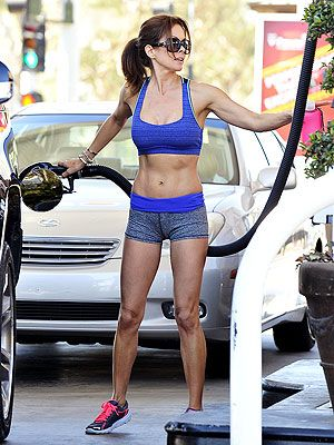 Brooke Burke-Charvet Talks About That Sexy Gas-Pumping Photo and what it takes to look fit at 42!