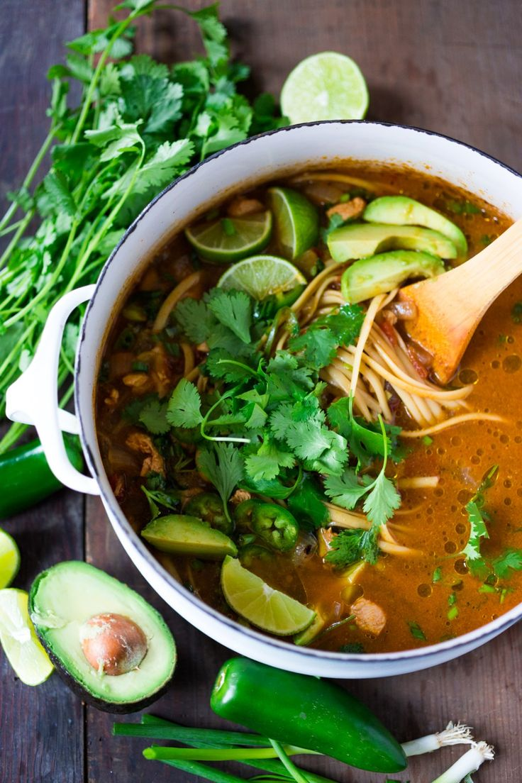 Flavorful, EASY Mexican Chicken Noodle Soup with cilantro, avocado and lime- a one pot meal, in under 30 minutes. Vegan option, sub chickpeas for the chicken!  www.feastingathome.com