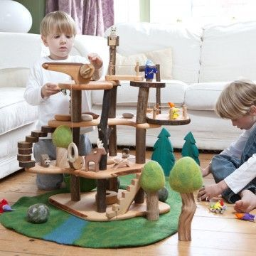 Wooden toy tower / dollhouse with landscape carpet and wooden trees