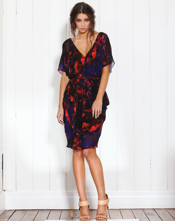 With it's vibrant colours you will feel gorgeous in this stunning floaty dress. For an evening look, wear with some heels and an oversized clutch. <br /> <br />Features: <br />- Black/Orange/Blue Chiffon Floral Print <br />- V Crossover Front (With Snap Fastener) and Back <br />- Short Batwing Sleeves <br />- Lined Body <br />-%2...