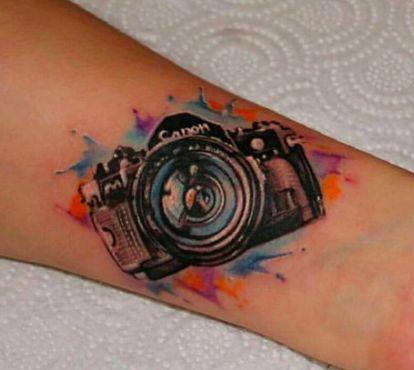 Watercolor camera tattoo, see on Instagram @polshina_ks.