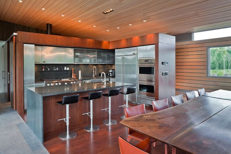 Stainless steel cabinets have been combined with wood to give this kitchen an industrial yet contemporary appearance.