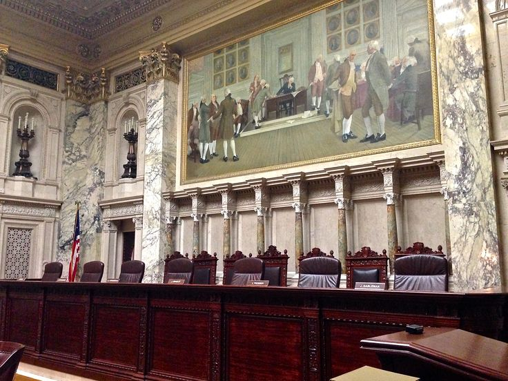 This is the Wisconsin Supreme Court.  There are seven elected justices on the Court.  They each serve ten-year terms.  The mural, here, was painted by Albert Herter.  It illustrates the signing of our Constitution in 1787.