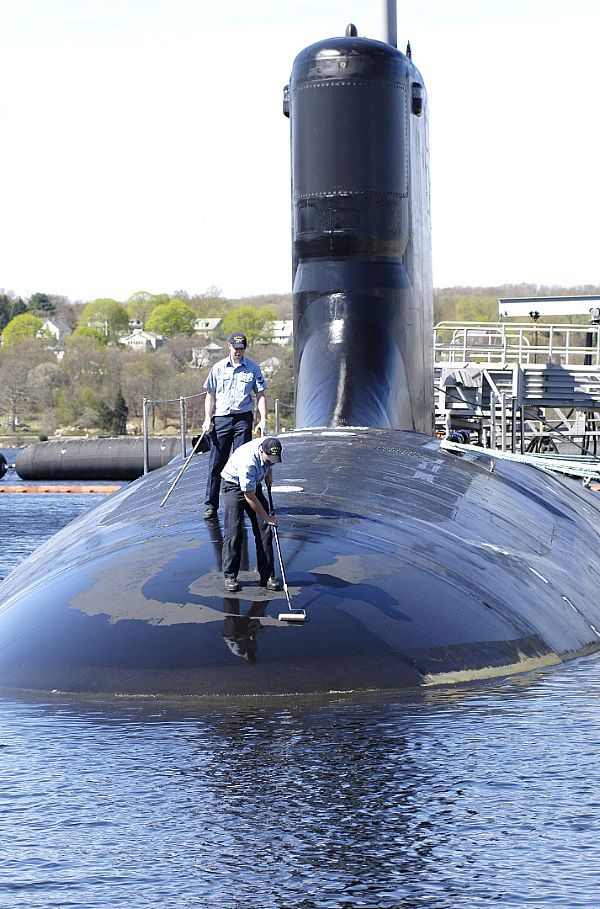 GROTON, Conn. (May. 5, 2007) Sailors assigned to Virginia-class fast-attack submarine PCU Hawaii (SSN 776) paint the submarine while moored at Submarine Base New London. PCU Hawaii is set to be commissioned Saturday, May 5th, at Submarine Base New London. U.S. Navy photo by John Narewski (RELEASED)