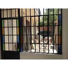 puerta mampara hierro vidrio repartido.