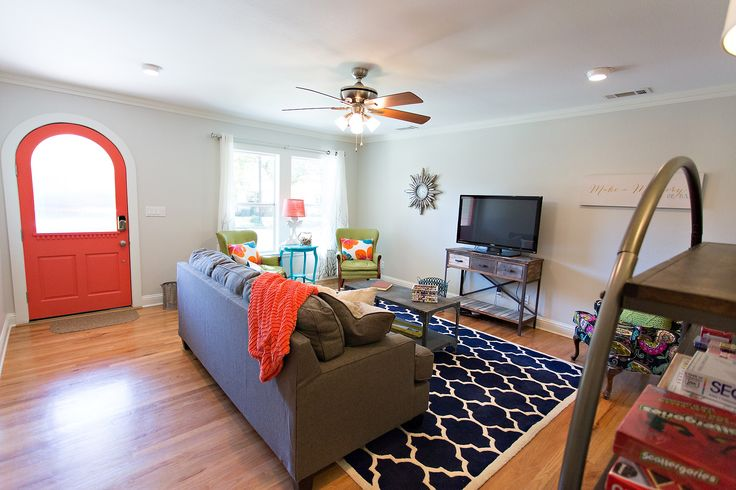 This is where we are staying over the 4th of July...check out these colored door properties! The Living Room at The Coral Door in Fredericksburg Texas