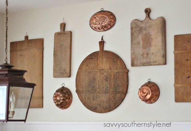 Savvy Southern Style: Gallery Wall in the Breakfast Room, vintage breadboards, vintage copper food molds, gallery wall, French country