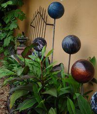 bowling ball + copper pipe = cool garden art