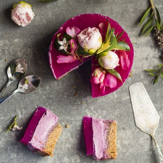 Pink dragon fruit cake with three layers: sponge, raw mousse and jelly. Can easily be customized!
