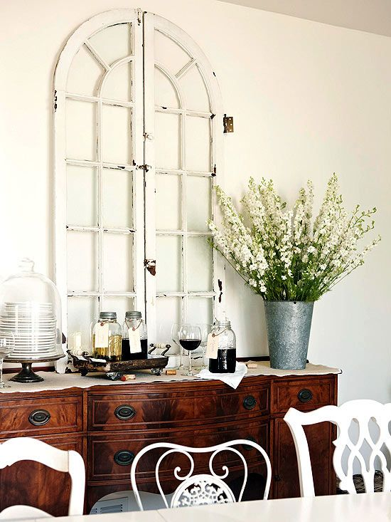 Faux Window Prop an aged window frame on a buffet or fireplace mantel to give the impression of a view where there is none and to create visual interest along a blank wall.