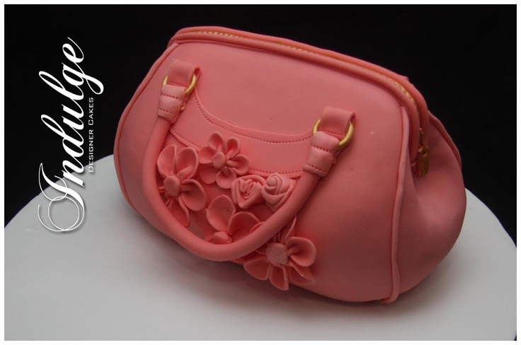 One last fabulous handbag design from Indulge Designer Cakes in Victoria (www.indulgedesignercakes.com.au). Aren't they just amazing? Maybe we should design a handbag that looks like a cake ...