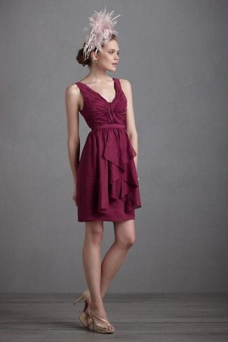 """Vivacity Shift  $240.00  STYLE: 24154833  Cascading ruffles and a pleated waistline add movement and volume beneath energetic rays of pintucking that define an elegant bodice on Quillaree's luxe silk and linen dress. From Quillaree. Interior boning for support. Back zip. Silk, linen; acetate lining. Dry clean. Imported.  A Quillaree original, exclusive to BHLDN  Falls 22.5"""" from natural waist  Also available in deep periwinkle and fire orange"""