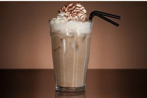 Blended vanilla mocha  Ingredients: 1/4 cup chilled strong coffee 1/4 cup ice cubes 1/4 cup milk 1 cup vanilla ice cream 1 Tbsp chocolate syrup Whipped cream, for garnish Directions:  Combine coffee, ice cubes, milk, ice cream and chocolate syrup in a blender and blend until smooth. Pour into a large glass and garnish with whipped cream. Recipe courtesy of sheknows.com