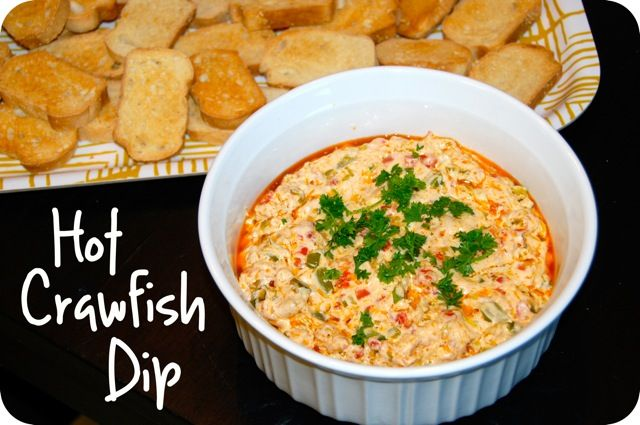 HOT CRAWFISH DIP  The dip Is like a cheesy version of etouffee, trust me, that isn't a bad thing...  1/2 C butter-1 C sliced green onions-  1 small bell pepper, finely diced-1 lb crawfish tails roughly chopped-2 garlic cloves, minced-1 (4 oz) jar diced pimentos, drained-2 tsp Cajun seasoning-1 (8 oz) pkg cream cheese, softened-Toasted baguette slices or crackers, for serving.