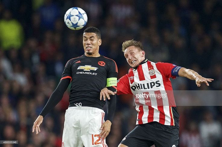 Chris Smalling of Manchester United, Luuk de Jong of PSV during the UEFA Champions League group B match