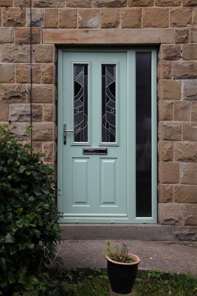Ludlow composite door in Chartwell Green with Abstract glass and integrated side panel.