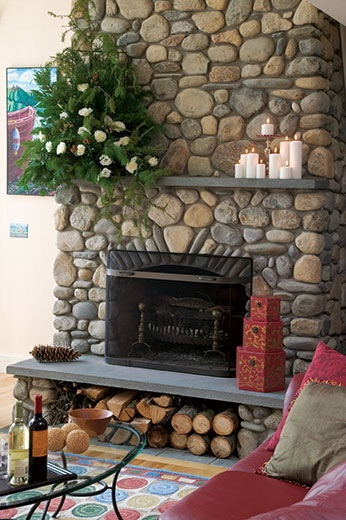 stone fireplace with wood storage underneath