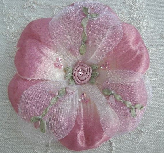 Thank you for stopping by my store today.    You will receive ONE 4 Satin and Organza Silk Emboidered HANDMADE FLOWER. Fashioned in a Soft Rose Pink shade.    There are 6 petals on the bottom that are Satin and 3 petals on the top that are Crystal Organza. The petals on the top are sheer Organza with handsewn Silk ribbons that have been embroidered to form tiny rosebuds on a stem with pale green leaves. The center is filled with a hand sewn silk spider rose with green ribbon leaves. Their…