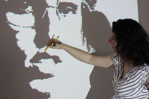 Use a projector to paint an image on the wall