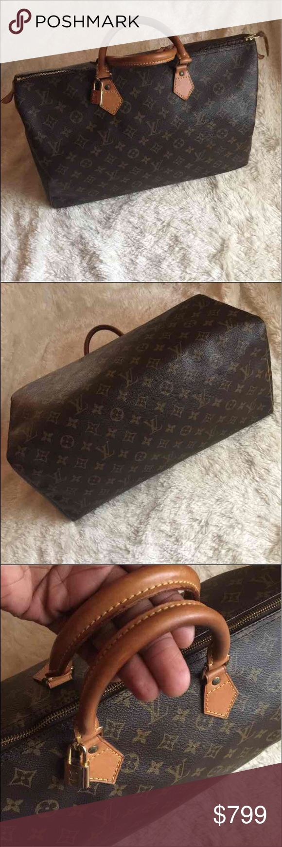 Louis Vuitton Speedy 40 Beautiful and pre-owned! 100% Authentic Louis Vuitton Monogram Speedy 40  Louis Vuitton Speedy 40 with brass hardware, tan vachetta leather trim, dual rolled handles, brown canvas lining, single pocket at interior wall and zip closure at top.   Good pre-owned condition with light signs of use. Patina on handles has darkened some adding to the beauty of the bag! Outside: Good. Very light Moderate scuffs on corner! Piping no holes or tears! Inside no visible stains, no…