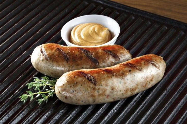 Bratwurst sausages -- or just brats -- are delicate pork and veal sausages that are sold raw. Popular in the Midwest, the sausages originated in Germany an