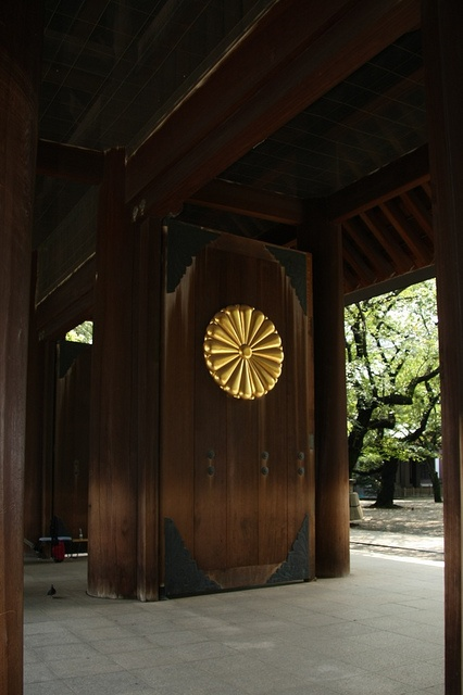 Door at Yasukuni Shrine, Tokyo, Japan: Yasukuni Shrine is dedicated to the kami (spirits) of soldiers and others who died fighting on behalf of the Emperor of Japan. 靖国神社