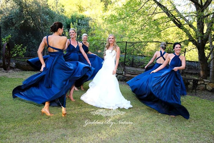 We  this beautiful dancing shot of gorgeous bride Katie & her bridal party in their Goddess By Nature Signature Ballgowns in Nautical Navy colour. Our Goddess dresses are so amazingly soft, comfy & flowing to dance in  even her glowing pregnant bridesmaid is dancing too.