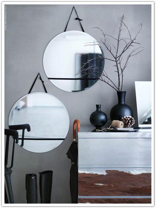 round mirrors & grey wall #display - Interesting printed cabinet
