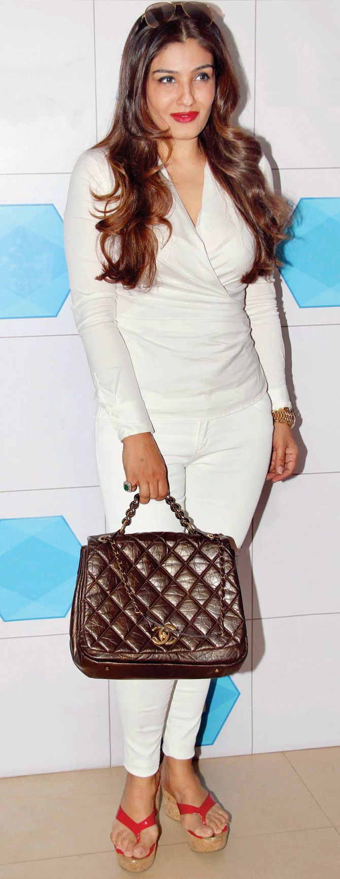 Raveena Tandon in an all-white ensemble at the inauguration of a sports hall at a Mumbai school. #Bollywood #Fashion #Style #Beauty #Hot #Sexy