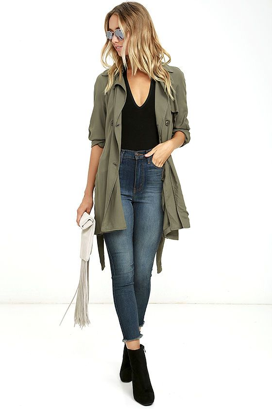 The Olive & Oak Kennedy Olive Green Trench Coat is an essential to any street chic wardrobe! This lightweight woven coat has all of the classic trench features, starting with a storm flap, gun flap, long sleeves, and a notched collar. The double breasted button closure front secures with a tying sash belt. Vertical welted pockets finish the look.