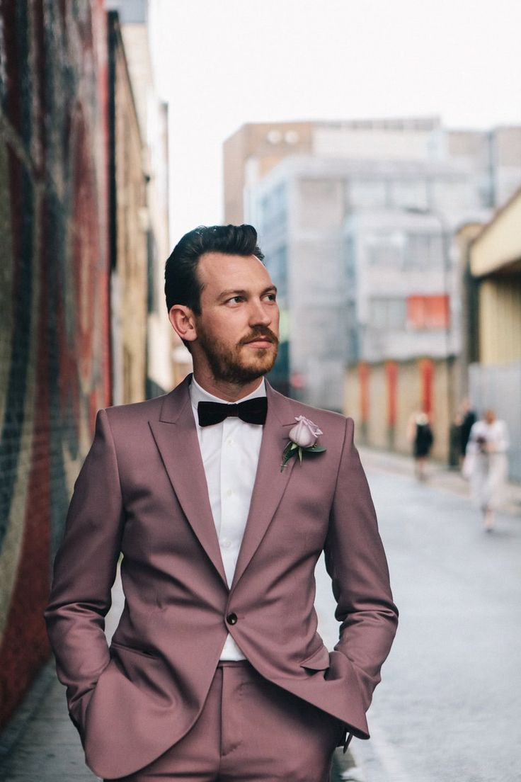 The groom wore a dusky purple Alexander McQueen suit. Emma wore a Self Portrait dress for her quirky, colourful and alternative, first look wedding. Photography by Eclection Photography http://eclection-photography.com/