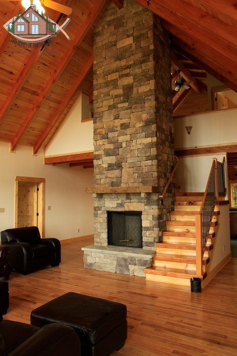 Wood Burning Insert Surrounded By Cultured Stone With