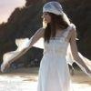 http://www.lemienozze.it/news/collezione-sposa-2013.html Abito da sposa con delicato velo che avvolge la silhouette