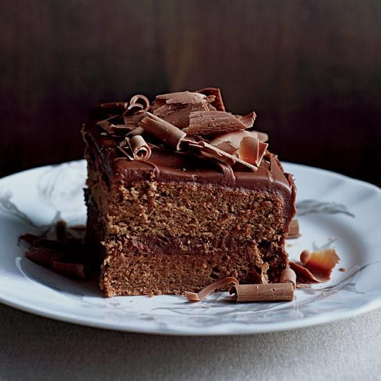 For this dessert, the ultracreamy icing, which is almost like a milk-chocolate ganache, gets spread liberally over layers of light, delicate, cocoa-flavored cake.