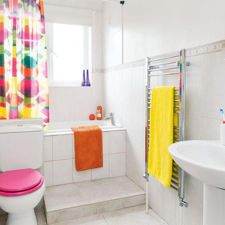 White Bathroom With Pink Yellow And Orange Accessories