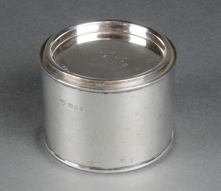 Lot 661, A novelty silver treacle tin with presentation inscription, London 1925, 194 grams, est £80-120