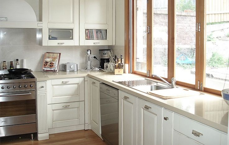 Concertina windows over sink looking out to deck