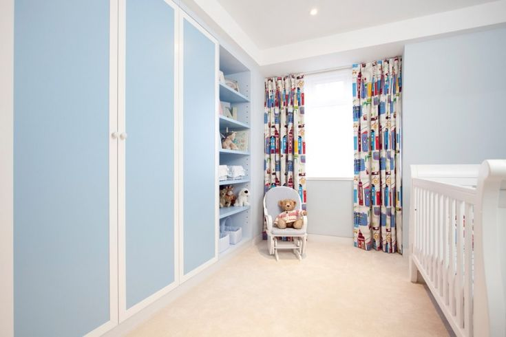 blue cupboard colored curtains teddy bear blue wall white crib white wall cream rug children chair of Bookshelf for Nursery Ideas for Beginner