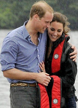 The Duke and Duchess of Cambridge cuddle after a competitive rowing race in which William won by a stroke!!!