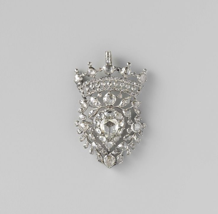 "Flemish Heart, Diamond and Silver,  ca. 1785 - ca. 1800. Silver pendant, entirely set with diamonds. In the form of a ""Flemish heart. Under an openwork crown hangs inside a heart-shaped leaves open a large diamond ring. (Hing originally a late monstrance and represents the heart of Mary.) ( Origin Possibly Southern Netherlands)"