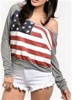 This trendy shirt is stretchy with a print of an American flag and can be worn off shoulder. Back Party on it. Looks hot with jeans shorts or A pair of leggings