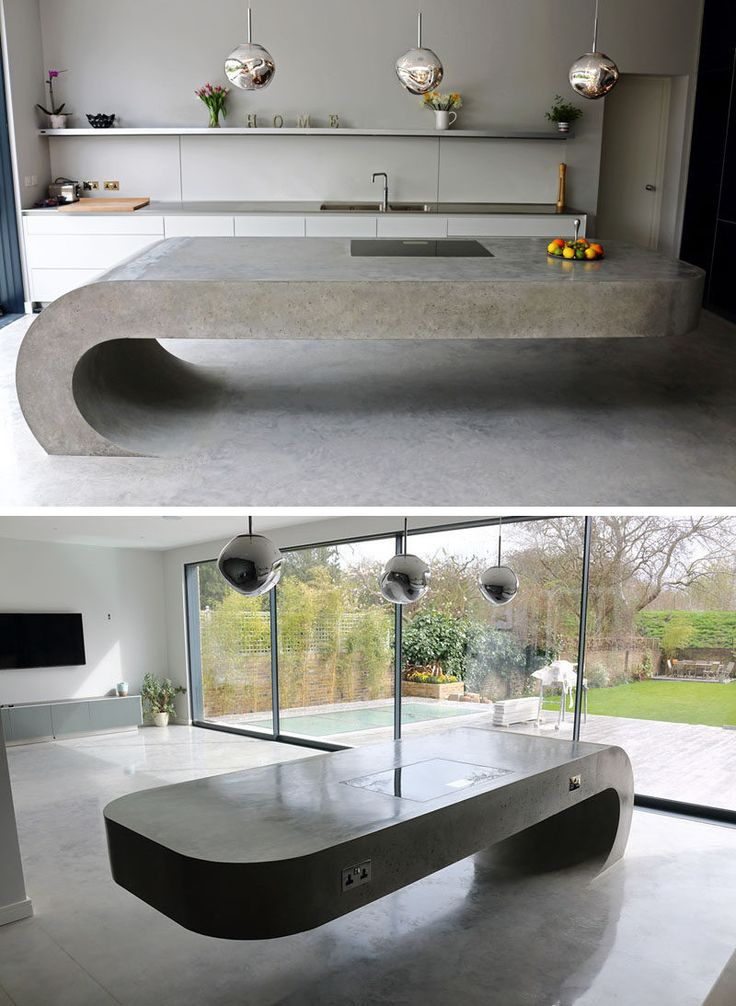 11 Creative Concrete Countertop Designs To Inspire You // This concrete kitchen island rises up out of the concrete floor and curves around in a gravity defying manner.