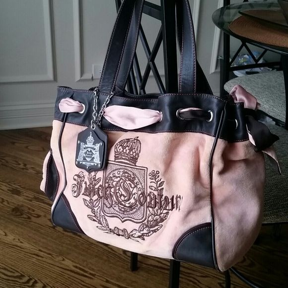 Juicy couture handbag Pink and brown juicy couture handbag. 2 stains on the left of bag. Barely noticable unless up close.  see picture 4 :) Juicy Couture Bags Shoulder Bags