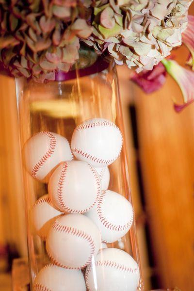 tall vase filled with baseballs