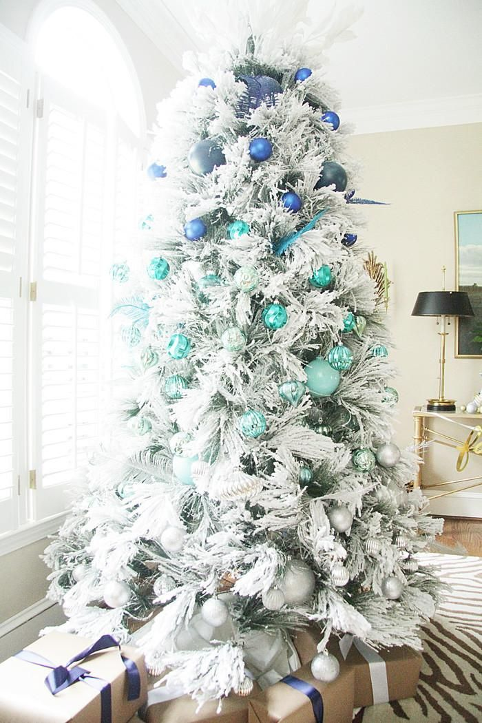 Christmas Tree Decoration Ideas - Al statement-making all white tree with cobalt blue and mint green bulb ornaments!
